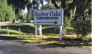 There is a big sign that says Harbor Oaks RV Sites, with an arrow pointing the way, at the 2nd entrance, that's brightly lit at night